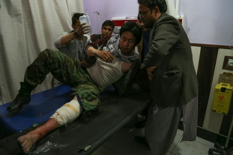 A wounded man receives treatment in a hospital after a suicide bombing in Kabul