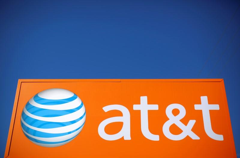 An AT&T sign is seen outside a branch in Rolling Meadows