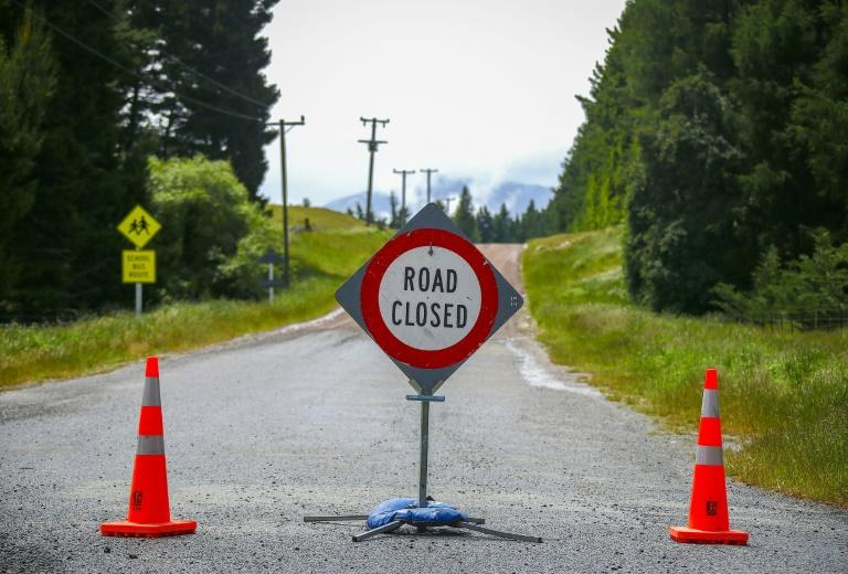 A road is closed due to flooding near Hakatere, on New Zealand's South Island (AFP Photo/DAVID GRAY)