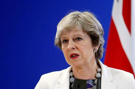 Britain's PM May addresses a news conference during EU leaders summit in Brussels
