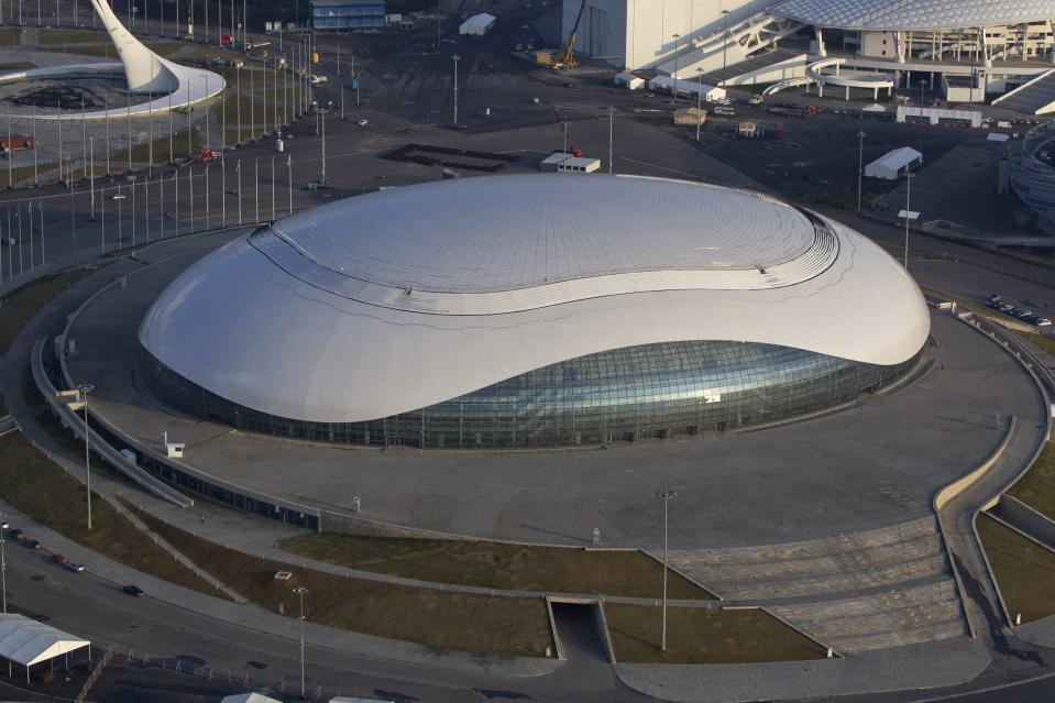 "An aerial view from a helicopter shows the ""Bolshoy"" Ice Dome at the Olympic Park in the Adler district of the Black Sea resort city of Sochi, December 23, 2013. Sochi will host the 2014 Winter Olympic Games in February. Picture taken December 23, 2013. REUTERS/Maxim Shemetov (RUSSIA - Tags: CITYSCAPE BUSINESS CONSTRUCTION SPORT OLYMPICS)"