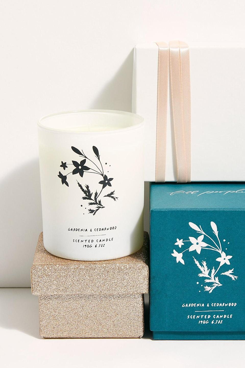 """<p>This <a href=""""https://www.popsugar.com/buy/Free-People-Gardenia-Cedarwood-Candle-527165?p_name=Free%20People%20Gardenia%20%2B%20Cedarwood%20Candle&retailer=freepeople.com&pid=527165&price=38&evar1=fab%3Aus&evar9=45460327&evar98=https%3A%2F%2Fwww.popsugar.com%2Ffashion%2Fphoto-gallery%2F45460327%2Fimage%2F46978016%2FFree-People-Gardenia-Cedarwood-Candle&list1=shopping%2Cgifts%2Cfree%20people%2Choliday%2Cgift%20guide%2Cgifts%20for%20women&prop13=api&pdata=1"""" class=""""link rapid-noclick-resp"""" rel=""""nofollow noopener"""" target=""""_blank"""" data-ylk=""""slk:Free People Gardenia + Cedarwood Candle"""">Free People Gardenia + Cedarwood Candle</a> ($38) always makes for a great present.</p>"""
