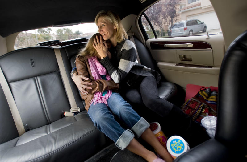 """In this April 13, 2011 photo, Stacey Rees, right, tries to keep daughter Jessica upbeat as they get ready to take a limousine ride to an """"American Idol"""" taping in Rancho Santa Margarita, Calif.  Jessica Joy Rees, 12, who started a blog and a Facebook page to raise awareness about child cancer has died of brain tumors.  Her family says Jessica died Thursday, Jan. 5, 2012 after a 10-month battle with cancer. Jessica Rees began her blog after she became sick in March. Her Internet posts described her feelings and urged her readers to pray for other children with cancer.  (AP Photo/Orange County Register, Ana Venegas)  MAGS OUT; LOS ANGELES TIMES OUT"""