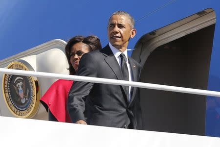 U.S. President Barack Obama and first lady Michelle Obama board Air Force One for travel to Alabama from Joint Base Andrews, Maryland March 7, 2015. REUTERS/Jonathan Ernst