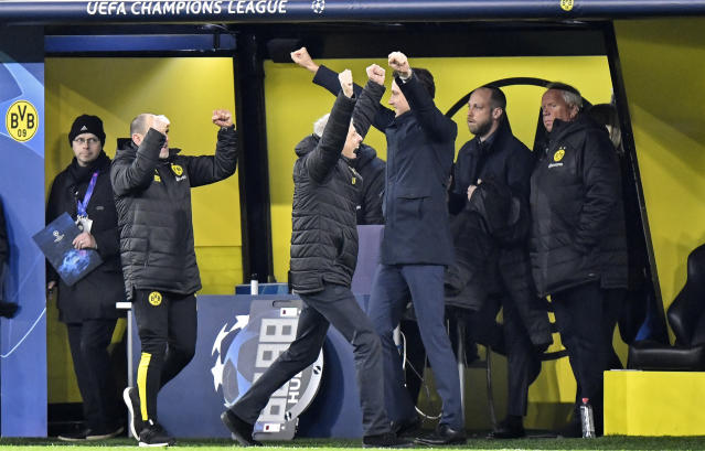 Dortmund's head coach Lucien Favre, center, celebrates after winning the Champions League Group F soccer match between Borussia Dortmund and Slavia Praha in Dortmund, Germany, Tuesday, Dec. 10, 2019. Borussia defeated Slavia with 2-1. (AP Photo/Martin Meissner)