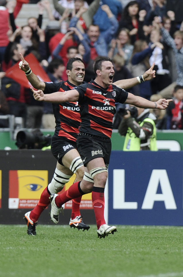 Toulouse's French flanker Gregory Lamboley (L) and Toulouse's French centre Louis Picamoles celebrate after winning the French Top 14 rugby union final match Toulouse vs Toulon, on June 9, 2011 at the Stade de France in Saint-Denis, outside Paris.  AFP PHOTO / FRED DUFOURFRED DUFOUR/AFP/GettyImages