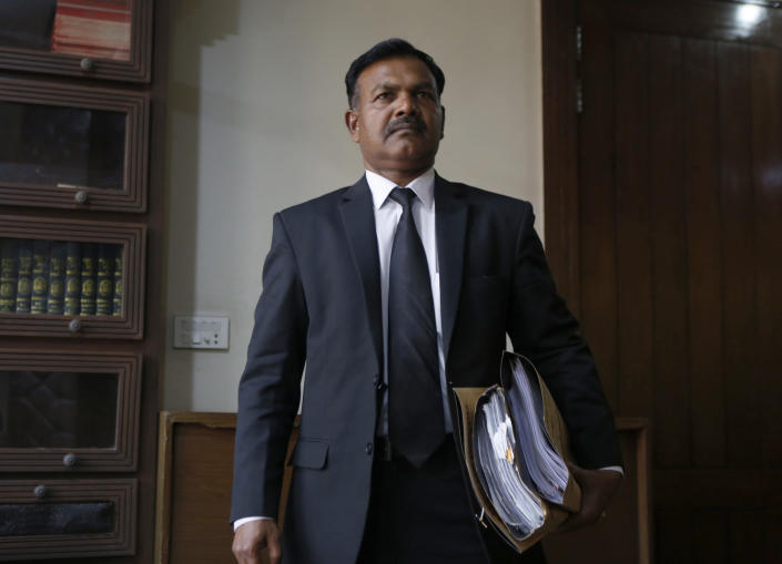 Naseeb Anjum, a lawyer for Nabeel Masih, a Christian man convicted while still a teenager in 2018 of blasphemy, arrives for an interview with The Associated Press, in Lahore, Pakistan, Monday, March 1, 2021. Anjum said a Pakistani court granted bail to Masih convicted of insulting Islam by posting a picture of Islam's holiest site on social media. (AP Photo/K.M. Chaudary)