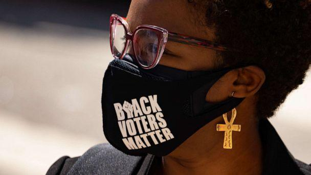 PHOTO: A woman protests outside the Capitol building in Atlanta in opposition of House Bill 531, which would impose voting restrictions, on March 8, 2021. (Megan Varner/Getty Images)