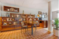 """<p>Choosing brown as an optimism-boosting wall color may seem counterintuitive, but when done properly, as shown here at <a href=""""https://www.thetempesthotel.com/"""" rel=""""nofollow noopener"""" target=""""_blank"""" data-ylk=""""slk:The Tempest Hotel"""" class=""""link rapid-noclick-resp"""">The Tempest Hotel</a> in Arizona, it exudes strength, security, and a connection to our natural environment. We love how this desert tone creates a cohesive indoor-outdoor space, but we also adore a rich chocolate brown for a sophisticated dining or sitting room that feels vibrant without being loud.</p>"""