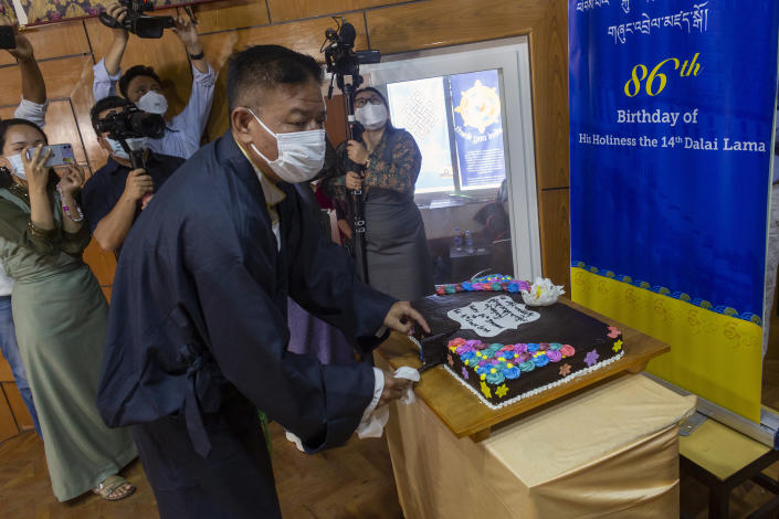 President of the Central Tibetan Administration Penpa Tsering, cuts a cake during a ceremony to mark the 86th birthday of their spiritual leader the Dalai Lama in Dharmsala, India, Tuesday, July 6, 2021. This year, due to the coronavirus pandemic, the celebrations were muted and behind closed doors. (AP Photo/Ashwini Bhatia)