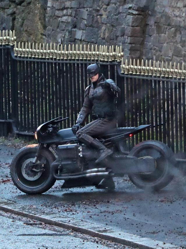 A man dressed as Batman gives a thumbs up as he sits on a motorcycle while filming continues in Glasgow for a new movie for the Batman superhero franchise. (Photo by Andrew Milligan/PA Images via Getty Images)
