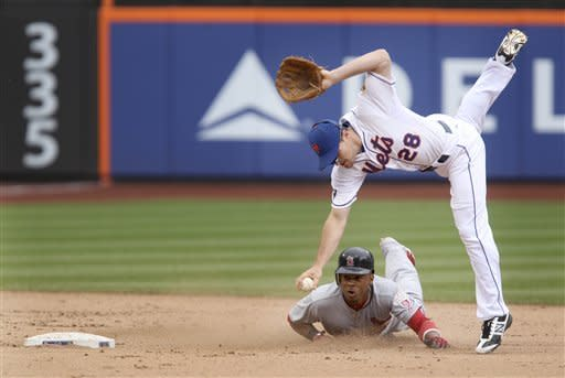 New York Mets second baseman Daniel Murphy, top, tags out St. Louis Cardinals' Adron Chambers during the seventh inning of the baseball game Monday, June 4, 2012, at Citi Field in New York. (AP Photo/Seth Wenig)