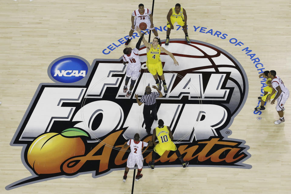 Louisville must vacate its 2013 national title and 2012 Final Four appearance after an NCAA decision on Tuesday. (AP)