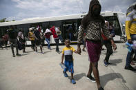Haitians who were deported from the United States arrive at the Toussaint Louverture International Airport, in Port au Prince, Haiti, Sunday, Sep. 19, 2021. (AP Photo/Rodrigo Abd)