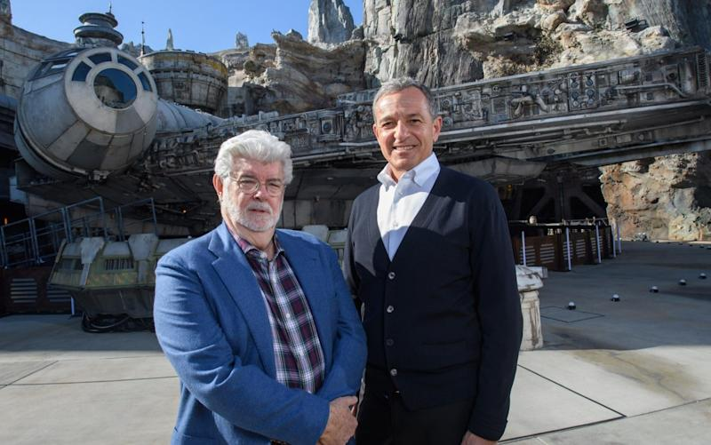Bob Iger, Disney's CEO, and George Lucas at Disney's new Star Wars theme park in California - Getty Images North America
