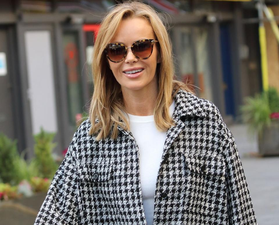Amanda Holden is bringing all the festive fun by sharing a video of herself washing windows dressed as Mrs Claus, pictured in November. (Getty Images)