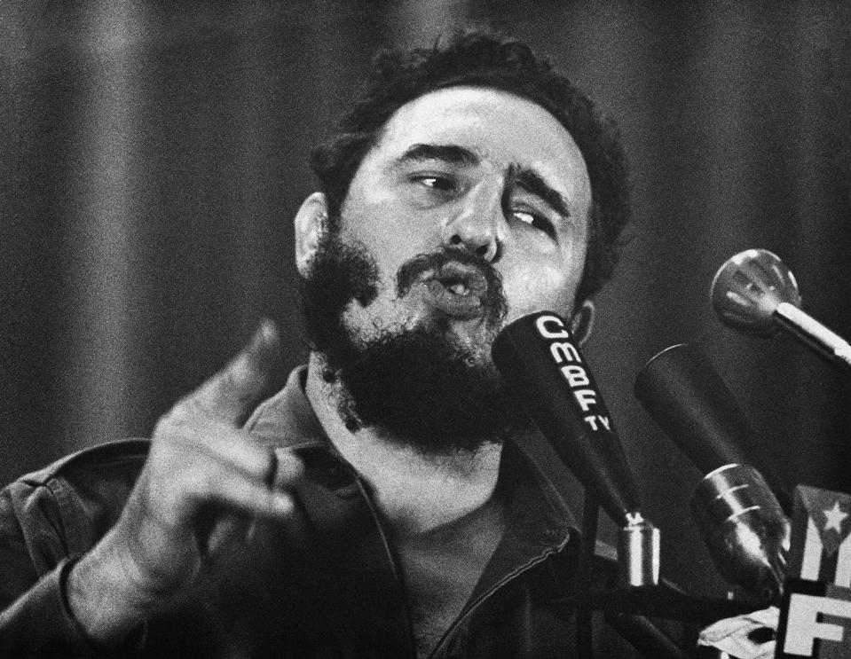 """<p>Cuban Prime Minister Fidel Castro speaks on the eve of the military trial of more than a hundred insurgents captured in the mountains on Wednesday Oct. 10, 1960 in Havana. He warns """"He who lives by the sword shall die by the sword"""" to those who attacked his regime. (AP Photo) </p>"""