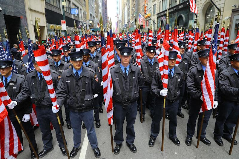Members of the FDNY Color Guard are prepared to march in the St. Patrick's Day Parade, March 16, 2019, in New York. (Photo: Gordon Donovan/Yahoo News)