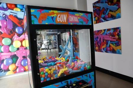 """A toy gun claw machine is seen as part of an art installation by artist WhIsBe titled """"Back to School Shopping"""" to illustrate the dangers of gun violence in schools, at a gallery in New York City"""