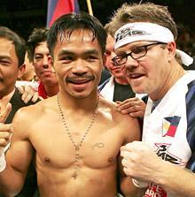 Pacquiao celebrates with his trainer Freddie Roach in 2006 after beating Erik Morales