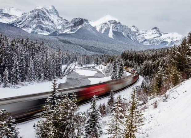 Lori Kupsch took this photo, Train Through the Mountains, in Banff National Park. Invest Alberta says it's reached a memorandum of understanding with Alberta Transportation and the Canada Infrastructure Bank for a train service that would link the Calgary airport and Banff. (Lori Kupsch - image credit)