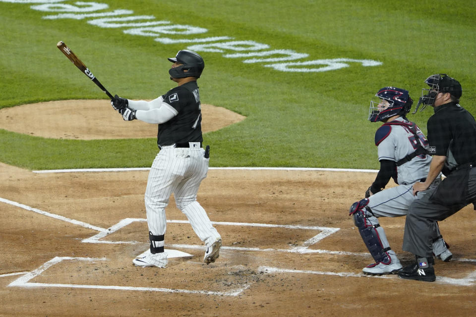 Chicago White Sox's Yermin Mercedes (73) hits a three-run home run against the Cleveland Indians during the first inning of a baseball game, Wednesday, April, 14, 2021, in Chicago. (AP Photo/David Banks)