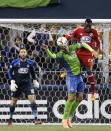 Seattle Sounders' Clint Dempsey, second from left, and FC Dallas' Je-Vaughn Watson (27) battle for a header in front of FC Dallas goalkeeper Chris Seitz, left, in the first half of an MLS western conference semifinal soccer match, Monday, Nov. 10, 2014, in Seattle. (AP Photo/Ted S. Warren)