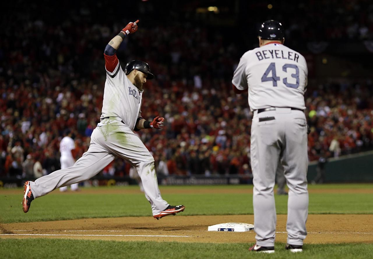 Boston Red Sox first base coach Arnie Beyeler watches as Jonny Gomes celebrates as he rounds first after hitting a three-run home run during the sixth inning of Game 4 of baseball's World Series against the St. Louis Cardinals Sunday, Oct. 27, 2013, in St. Louis.(AP Photo/Jeff Roberson)