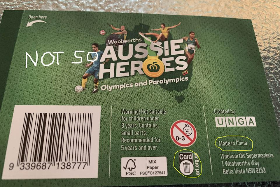 A Woolworths Aussie Heroes sticker package shown with the writing Made in China circled.