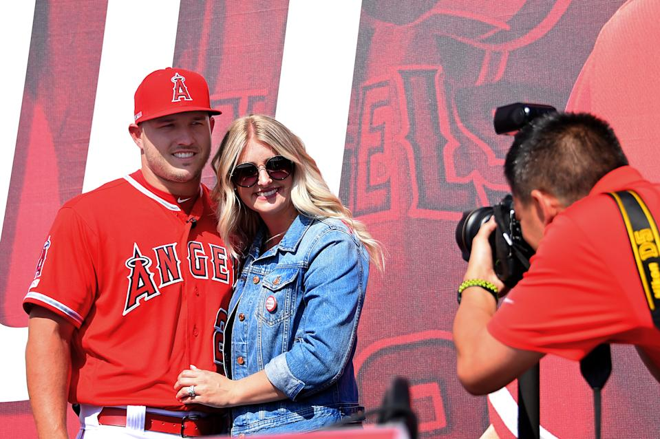 ANAHEIM, CA - MARCH 24: Mike Trout #27 of the Los Angeles Angels of Anaheim poses for a photo with his wife Jessica after press conference to discuss his new 12-year, $430 million contract extension at Angel Stadium of Anaheim on March 24, 2019 in Anaheim, California. (Photo by Jayne Kamin-Oncea/Getty Images)