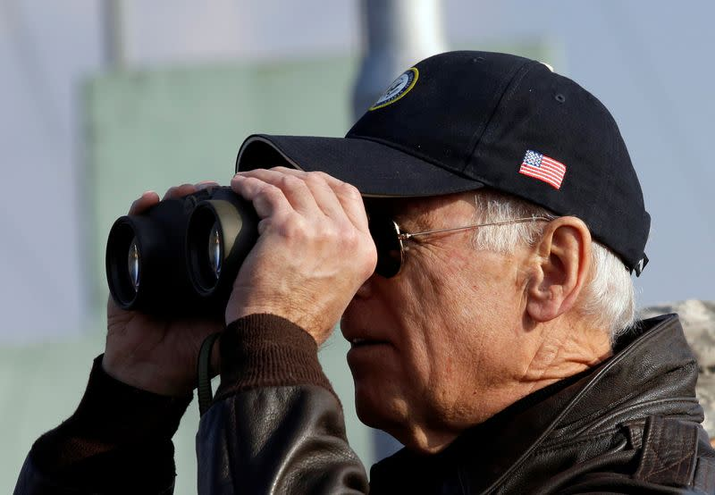 FILE PHOTO: U.S. Vice President Joe Biden looks through binoculars to see North Korea from Observation Post Ouellette during a tour of the DMZ, the military border separating the two Koreas, in Panmunjom