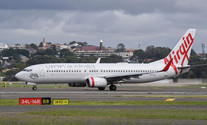 A Virgin Australia Boeing 737-800 series aircraft on the runway at Sydney's main international airport, Kingsford Smith, on March 15, 2020 in Sydney, Australia.