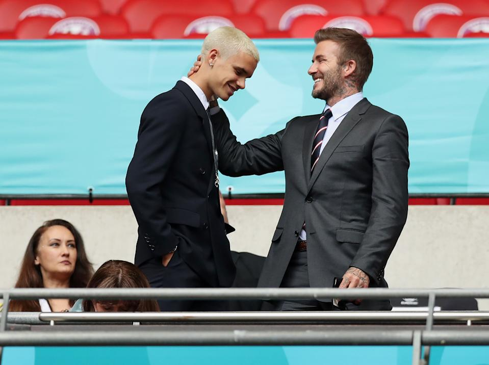 LONDON, ENGLAND - JUNE 29: Romeo James Beckham and his father, David Beckham react during the UEFA Euro 2020 Championship Round of 16 match between England and Germany at Wembley Stadium on June 29, 2021 in London, England. (Photo by Alex Morton - UEFA/UEFA via Getty Images)