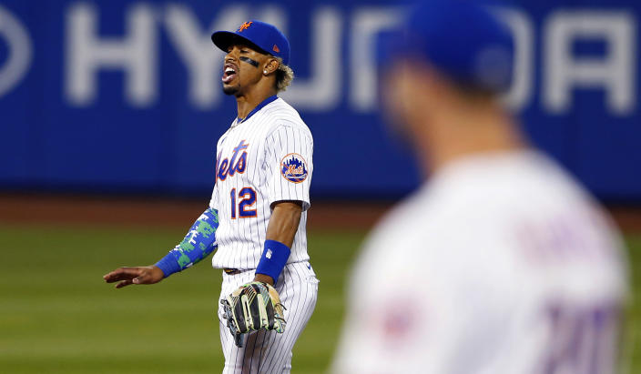 New York Mets' Francisco Lindor (12) reacts after New York Yankees' Giancarlo Stanton (27) hit a home run in the seventh inning of a baseball game, Sunday, Sept. 12, 2021, in New York. (AP Photo/Noah K. Murray)