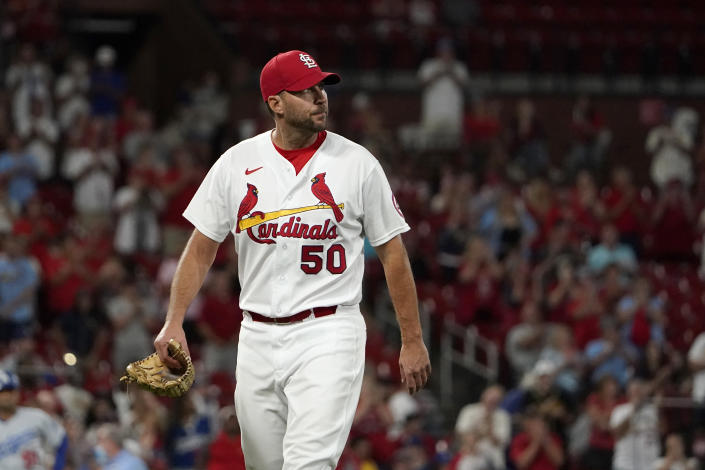 St. Louis Cardinals starting pitcher Adam Wainwright walks off the field after being removed during the ninth inning of a baseball game Wednesday, Sept. 8, 2021, in St. Louis. (AP Photo/Jeff Roberson)