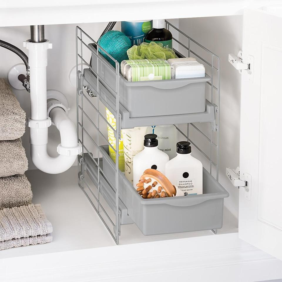 "<p>We love that this <a href=""https://www.popsugar.com/buy/Sliding-2-Drawer-Organizer-547069?p_name=Sliding%202-Drawer%20Organizer&retailer=containerstore.com&pid=547069&price=20&evar1=casa%3Aus&evar9=47213093&evar98=https%3A%2F%2Fwww.popsugar.com%2Fphoto-gallery%2F47213093%2Fimage%2F47213219%2FSliding-2-Drawer-Organizer&list1=shopping%2Corganization%2Chome%20organization%2Cmarie%20kondo%2Chome%20shopping&prop13=api&pdata=1"" class=""link rapid-noclick-resp"" rel=""nofollow noopener"" target=""_blank"" data-ylk=""slk:Sliding 2-Drawer Organizer"">Sliding 2-Drawer Organizer</a> ($20) makes it easy to access all your products.</p>"