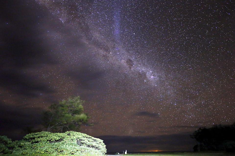 The Milky Way is seen in the sky above a path and huts on Lady Elliot Island located north-east of the town of Bundaberg in Queensland, Australia, June 10, 2015. UNESCO World Heritage delegates recently snorkelled on Australia's Great Barrier Reef, thousands of coral reefs, which stretch over 2,000 km off the northeast coast. Surrounded by manta rays, dolphins and reef sharks, their mission was to check the health of the world's largest living ecosystem, which brings in billions of dollars a year in tourism. Some coral has been badly damaged and animal species, including dugong and large green turtles, are threatened. UNESCO will say on Wednesday whether it will place the reef on a list of endangered World Heritage sites, a move the Australian government wants to avoid at all costs, having lobbied hard overseas. Earlier this year, UNESCO said the reef's outlook was
