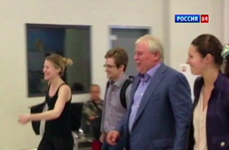 Sarah Harrison, a legal researcher for WikiLeaks, Snowden, Kucherena, and his assistant Valentina at Moscow's Sheremetyevo airport on Aug. 1, 2013. (Source: Rossiya 24 TV)