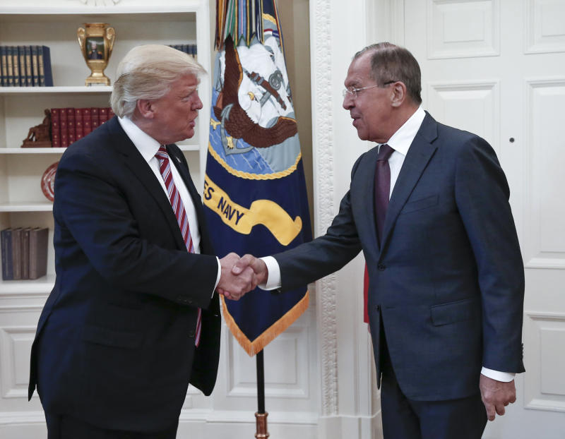 US President Donald Trump, left, shakes hands with Russian Foreign Minister Sergey Lavrov in the White House in Washington, Wednesday, May 10, 2017. (Photo: Russian Foreign Ministry Photo via AP)