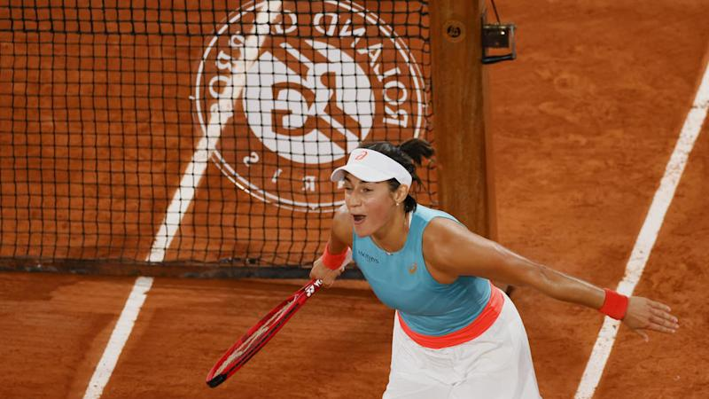 Local heroine Garcia salutes the fans as she advances to French Open last 16