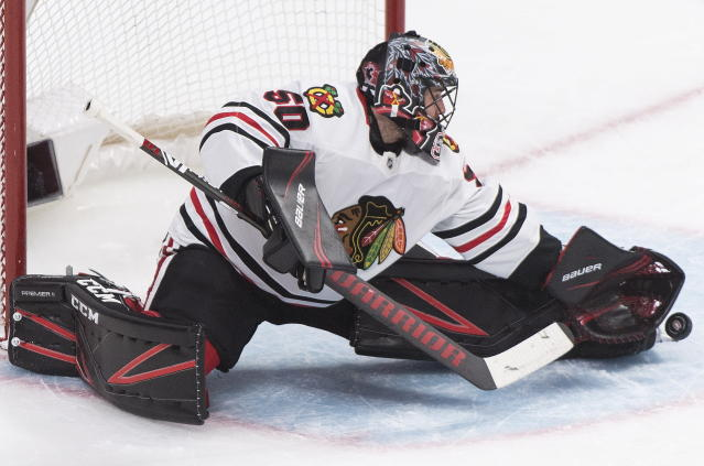 Chicago Blackhawks goaltender Corey Crawford makes a save against the Montreal Canadiens during the third period of an NHL hockey game Wednesday, Jan. 15, 2020, in Montreal. (Graham Hughes/The Canadian Press via AP)