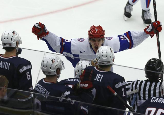 Russia's Pavel Buchnevich celebrates after scoring the winning goal in front of U.S. players in their IIHF Ice Hockey World Championship quarter-final match in Malmo January 2, 2014. REUTERS/Alexander Demianchuk (SWEDEN - Tags: SPORT ICE HOCKEY TPX IMAGES OF THE DAY)