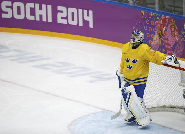 Sweden goaltender Henrik Lundqvist looks up at the scoreboard after Finland forward Olli Jokinen scored on him during the second period of the men's semifinal ice hockey game at the 2014 Winter Olympics, Friday, Feb. 21, 2014, in Sochi, Russia. (AP Photo/Matt Slocum)