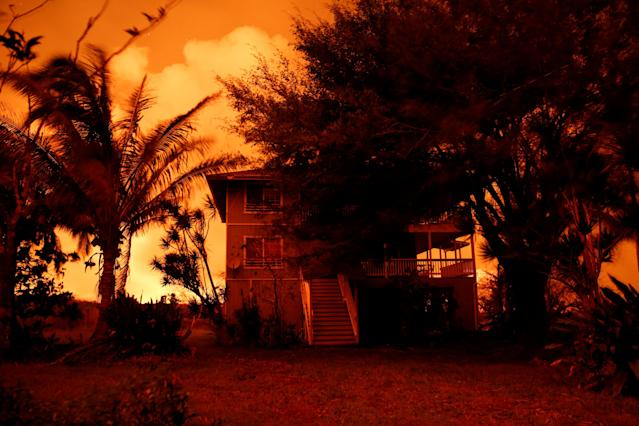 <p>Lava illuminates an evacuated house on the outskirts of Pahoa during ongoing eruptions of the Kilauea Volcano in Hawaii, June 6, 2018. (Photo: Terray Sylvester/Reuters) </p>
