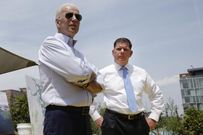 FILE - In this June 5, 2019, file photo, then- Democratic presidential candidate Joe Biden, led, stands with Boston Mayor Marty Walsh, right, during a campaign stop in Boston. Boston is facing a historic political pivot with the expected departure of Mayor Walsh to become President Joe Biden's labor secretary. (AP Photo/Steven Senne, File)