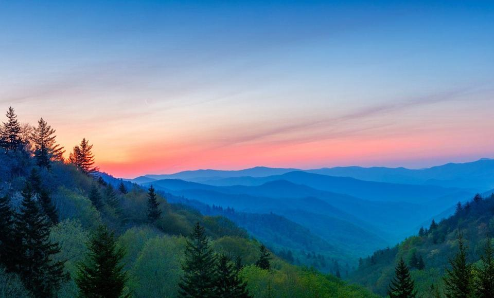 <p>If you've ever wondered how the Great Smoky Mountains range got its name, you'll see why as the pre-dawn haze the mist of the morning makes the hills appear to be filled with a soft, blue smoke. </p>