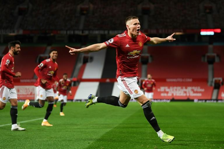 Flying high: Scott McTominay (right) scored twice as Manchester United beat Leeds 6-2 to move up to third