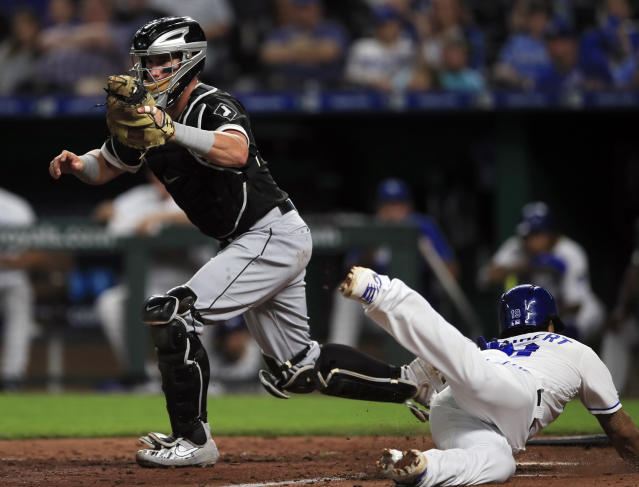 Chicago White Sox catcher James McCann, left, forces out Kansas City Royals' Cheslor Cuthbert (19) during the eighth inning of a baseball game at Kauffman Stadium in Kansas City, Mo., Monday, July 15, 2019. (AP Photo/Orlin Wagner)