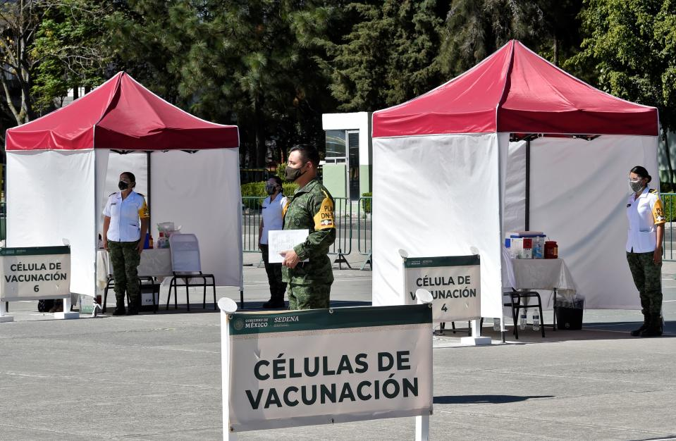 Medical personnel from different institutions and the Mexican Army wait to start applying the Pfizer/BioNTech COVID-19 vaccine, at the Military Field Number 1A in Mexico City on December 28, 2020. - Mexico will first apply the vaccine to all health personnel and the elderly as part of their mass immunization program. (Photo by Alfredo ESTRELLA / AFP) (Photo by ALFREDO ESTRELLA/AFP via Getty Images)