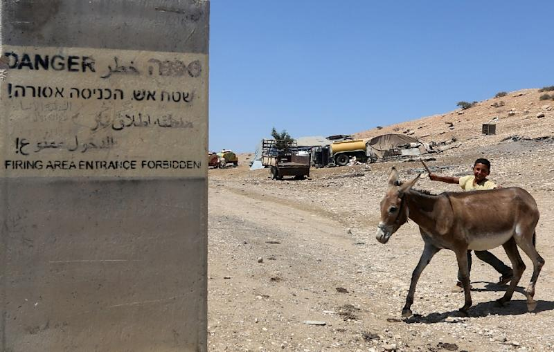 "A sign on a concrete block reads ""Firing area entrance forbidden"" in Hebrew, Arabic and English (AFP Photo/Jaafar Ashtiyeh)"